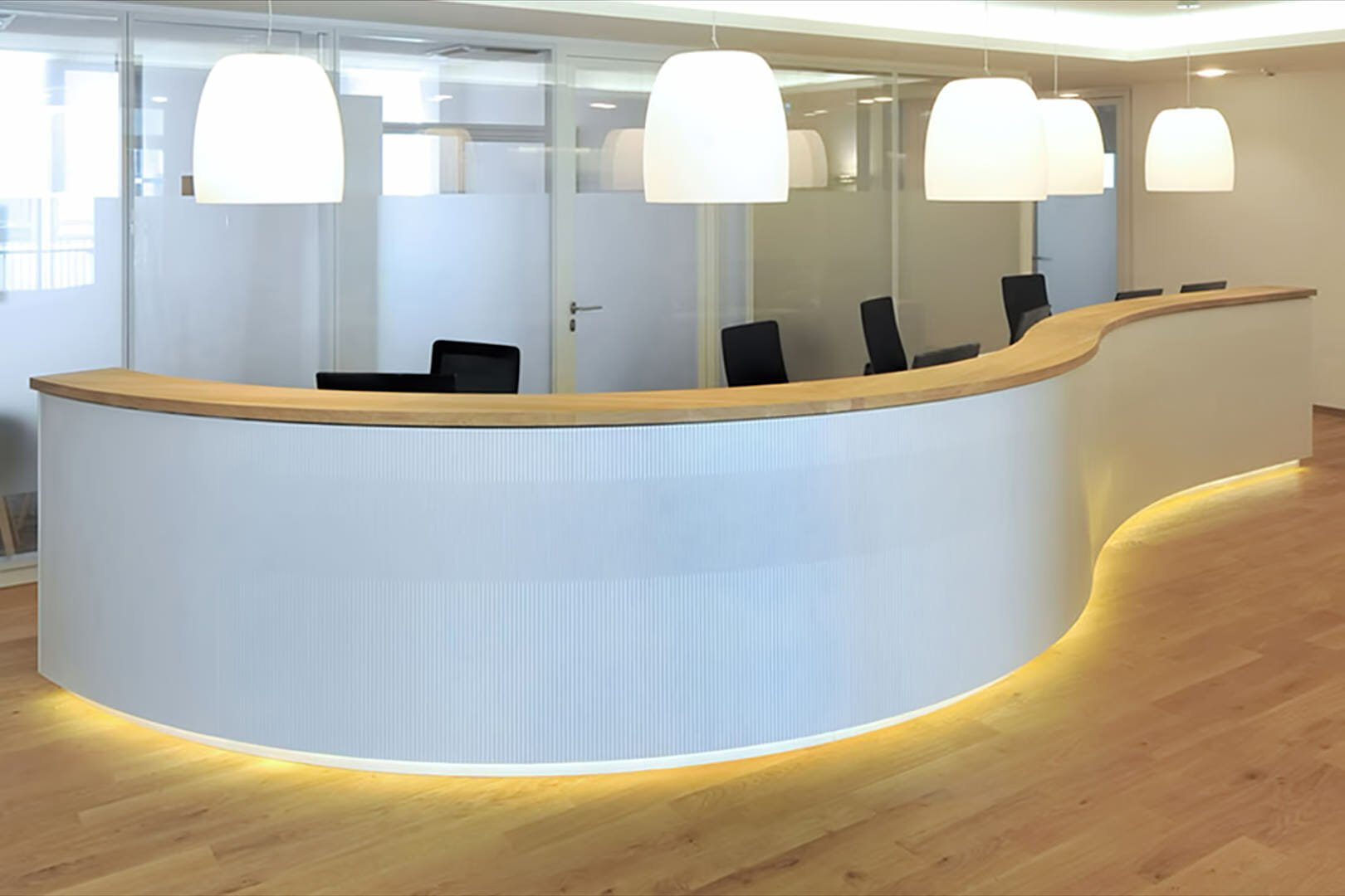curve wall using like wave as reception desk by entrance
