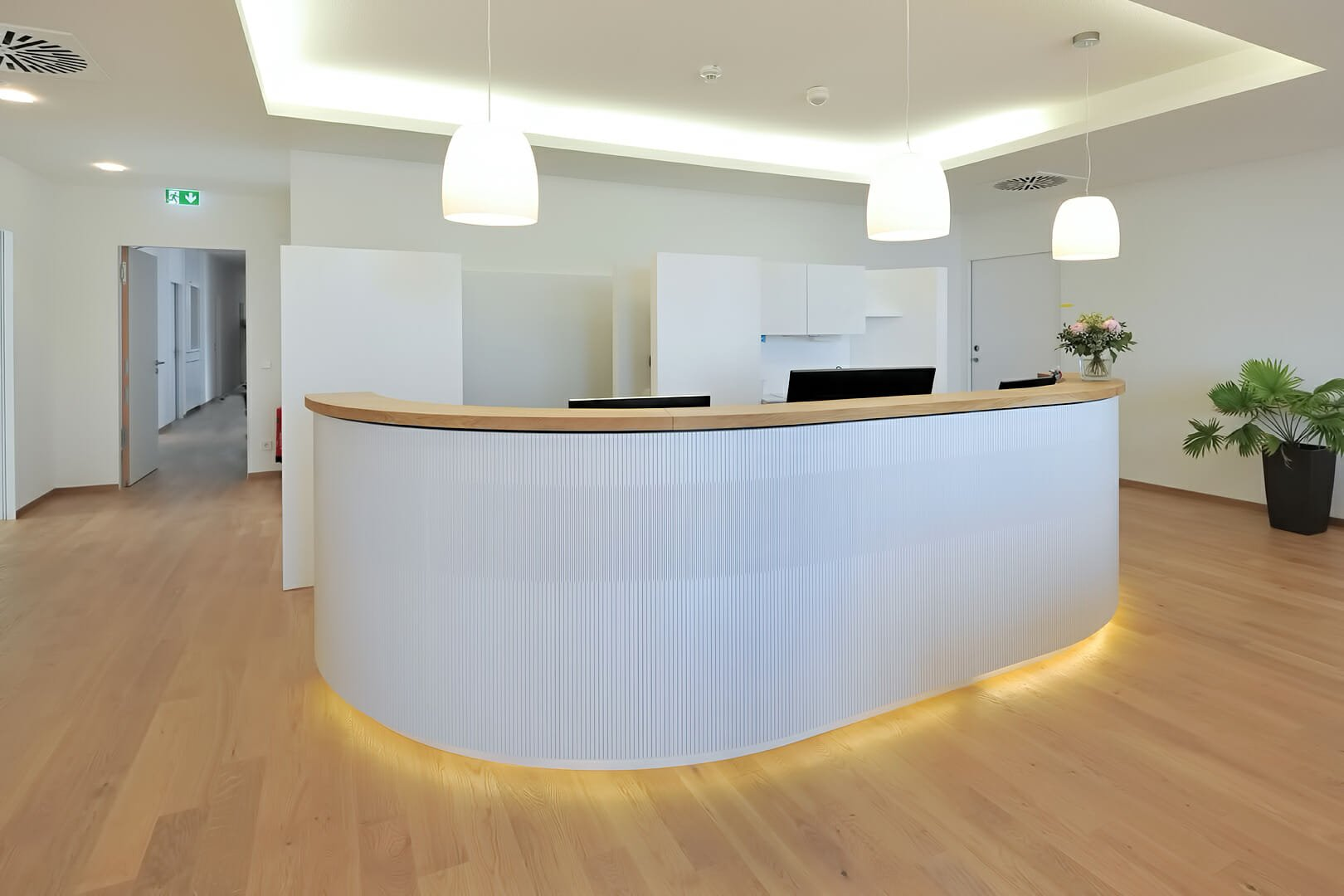 curve wall using as reception desk for patients