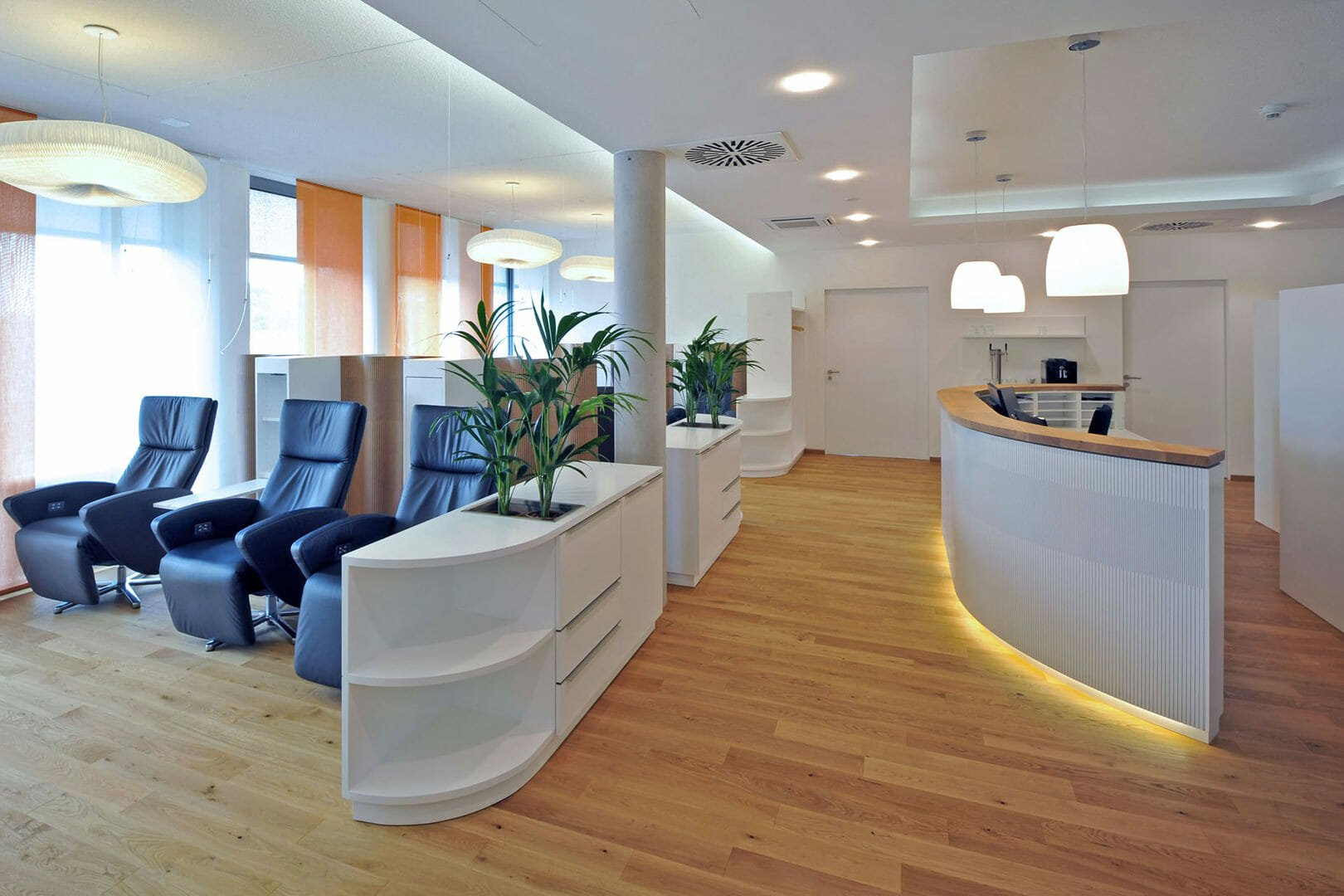 curve wall using as reception desk for patients and waiting area