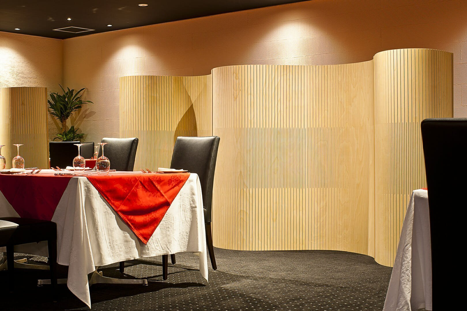 wood partition creating relaxed space for people in restaurant