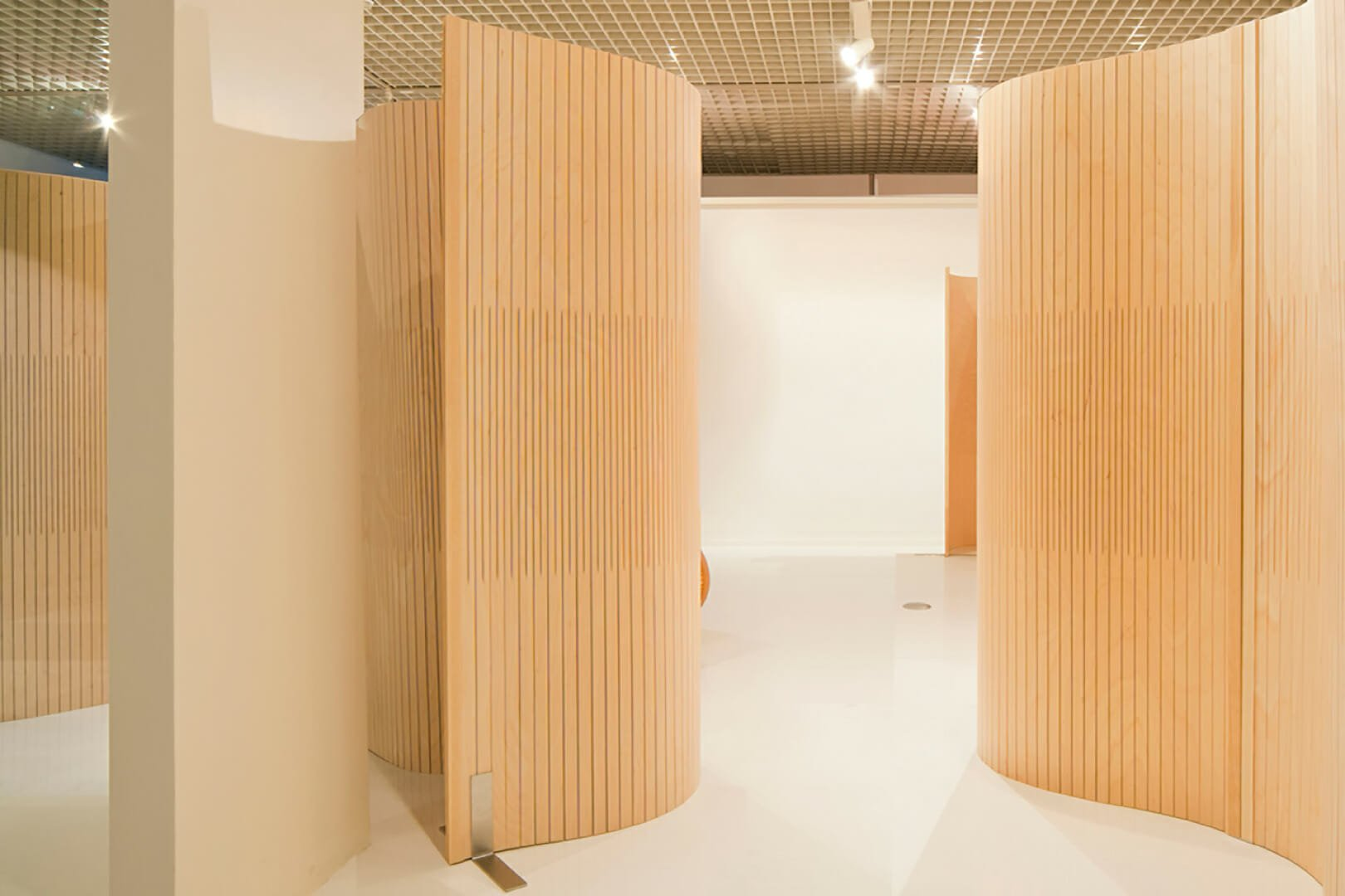 wood partition undulating in gallery entrance